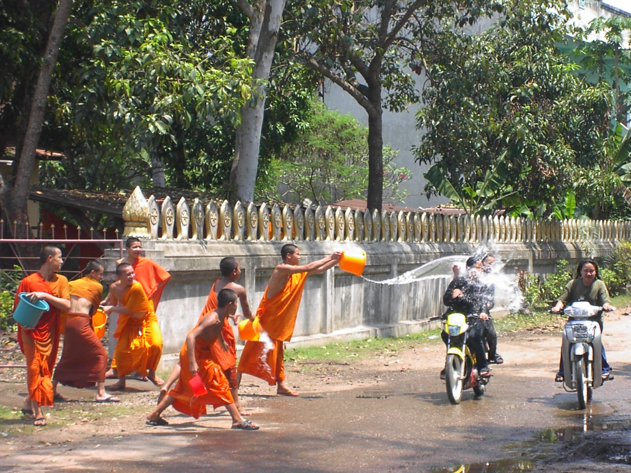 Water throwing in New Year Festival. Monks also enjoy it!