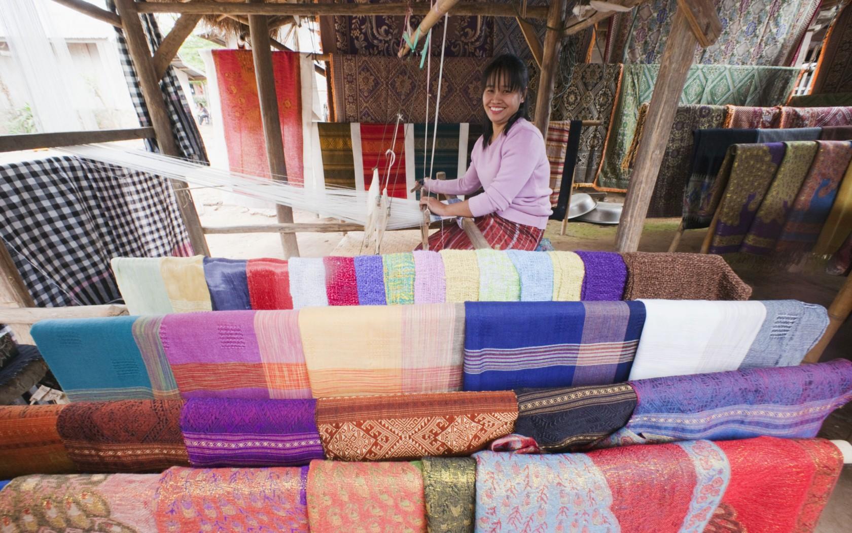 Woman weaving silk scarves, Ban Xang Hai Village, Luang Prabang, Laos.