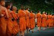Buddhist Monks Walking Along The Street During The Daily Ritual