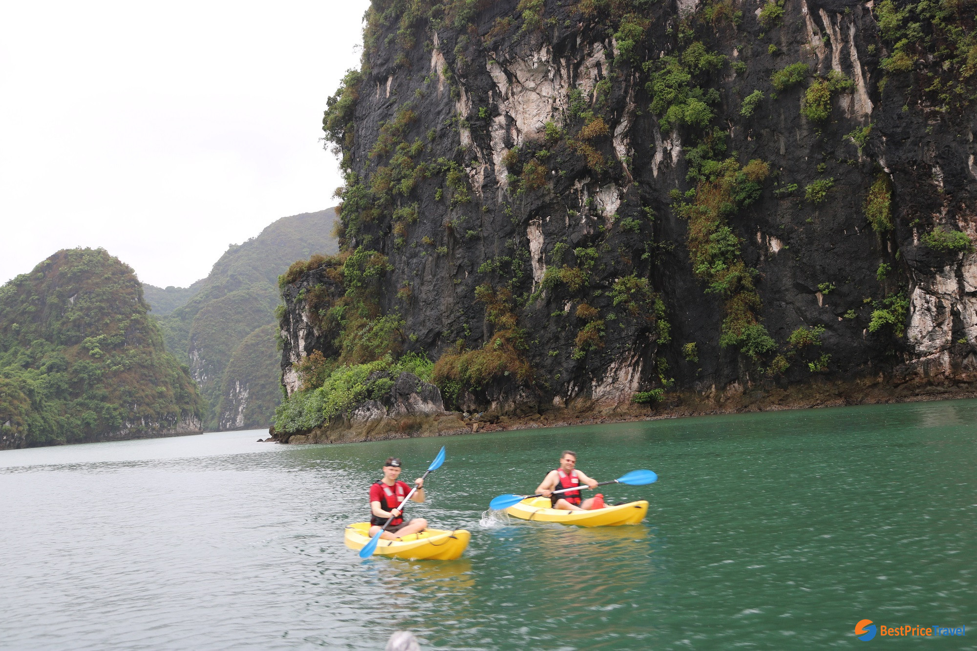 Kayaking when doing budget Halong Bay Cruise
