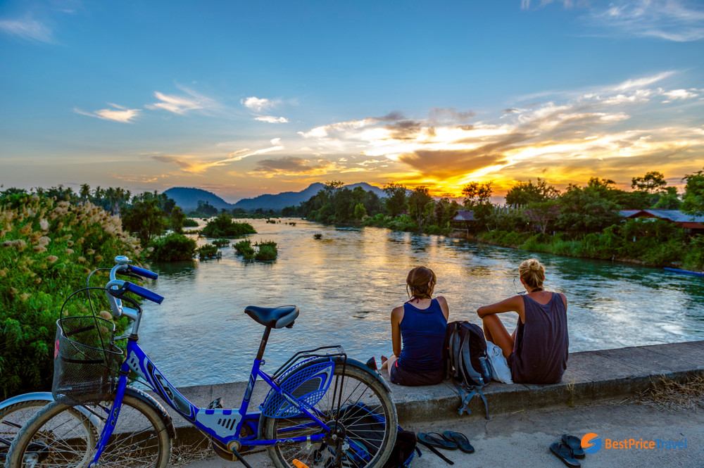 Tourists Looking At The Mekong River