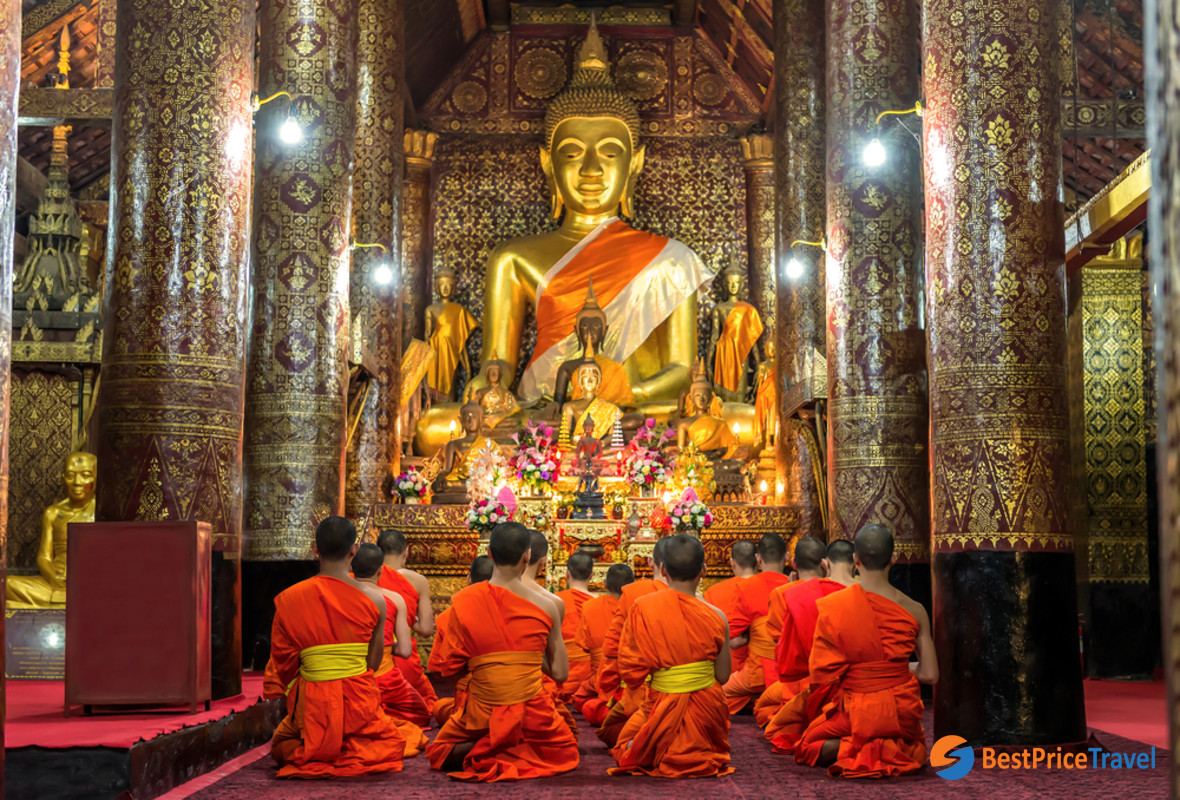 The monks are praying in the temple hall