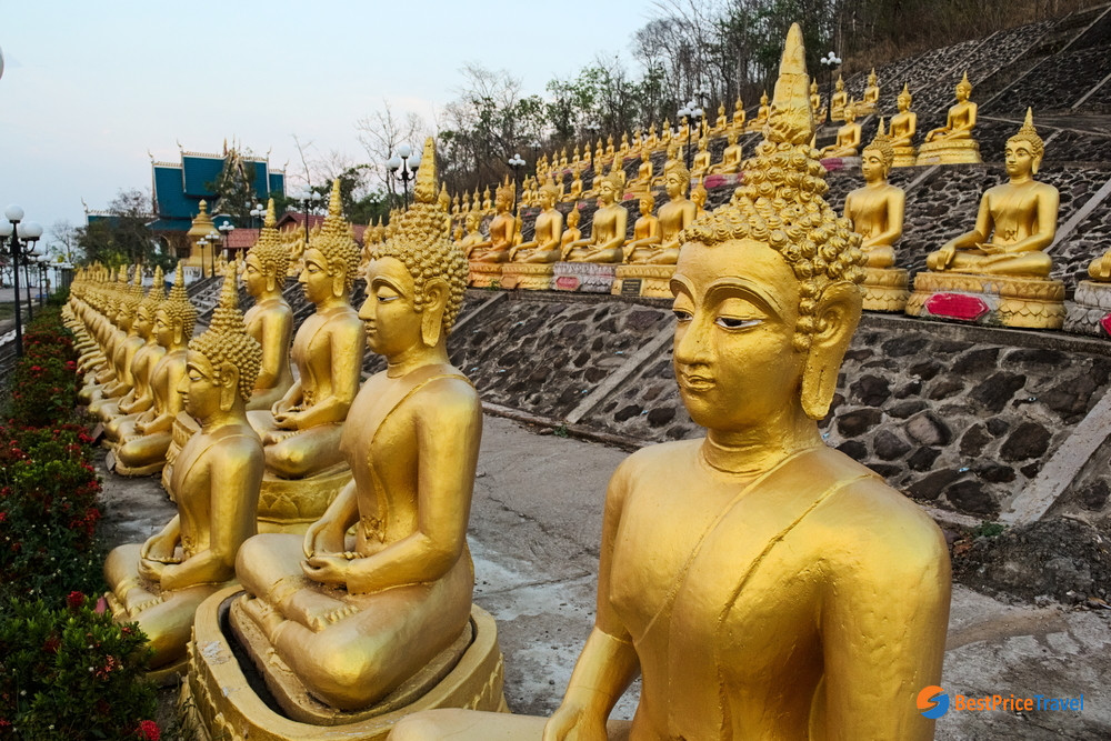 The small golden stupas on the top of Phou Salao