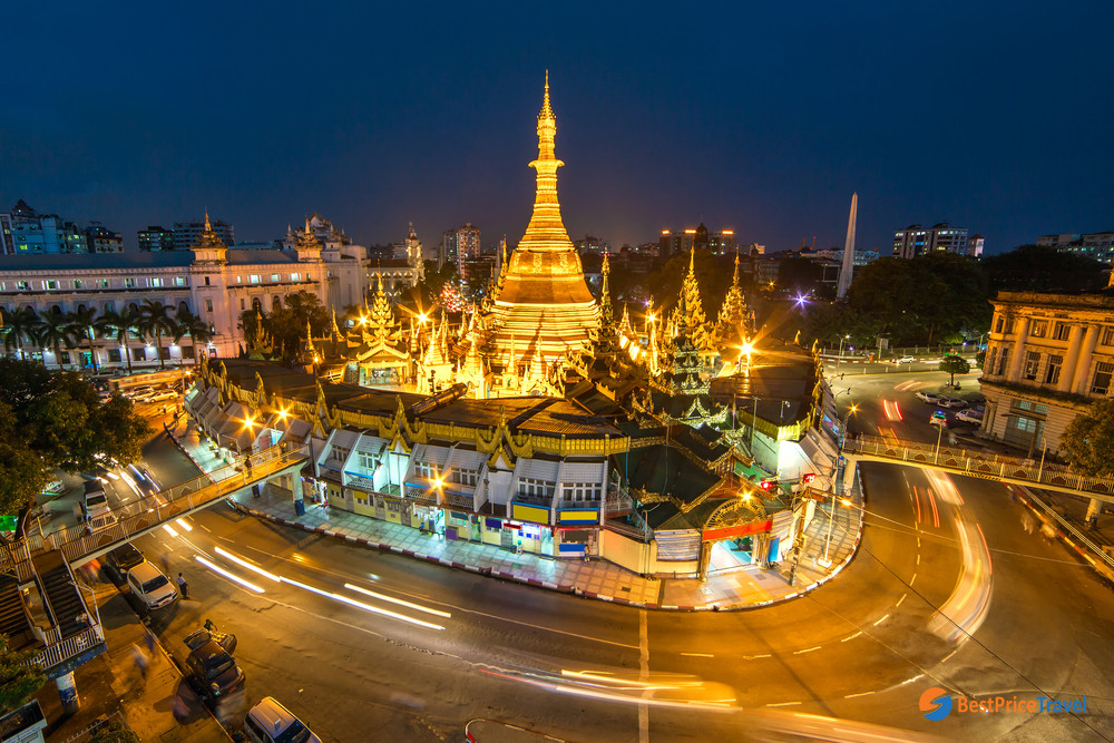 The glowing Sule Pagoda at night