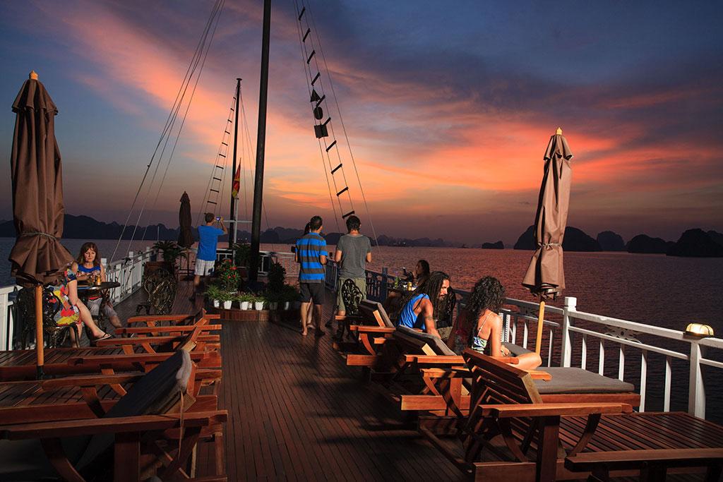 Enjoy Sunset view on Sundeck of budget halong cruise