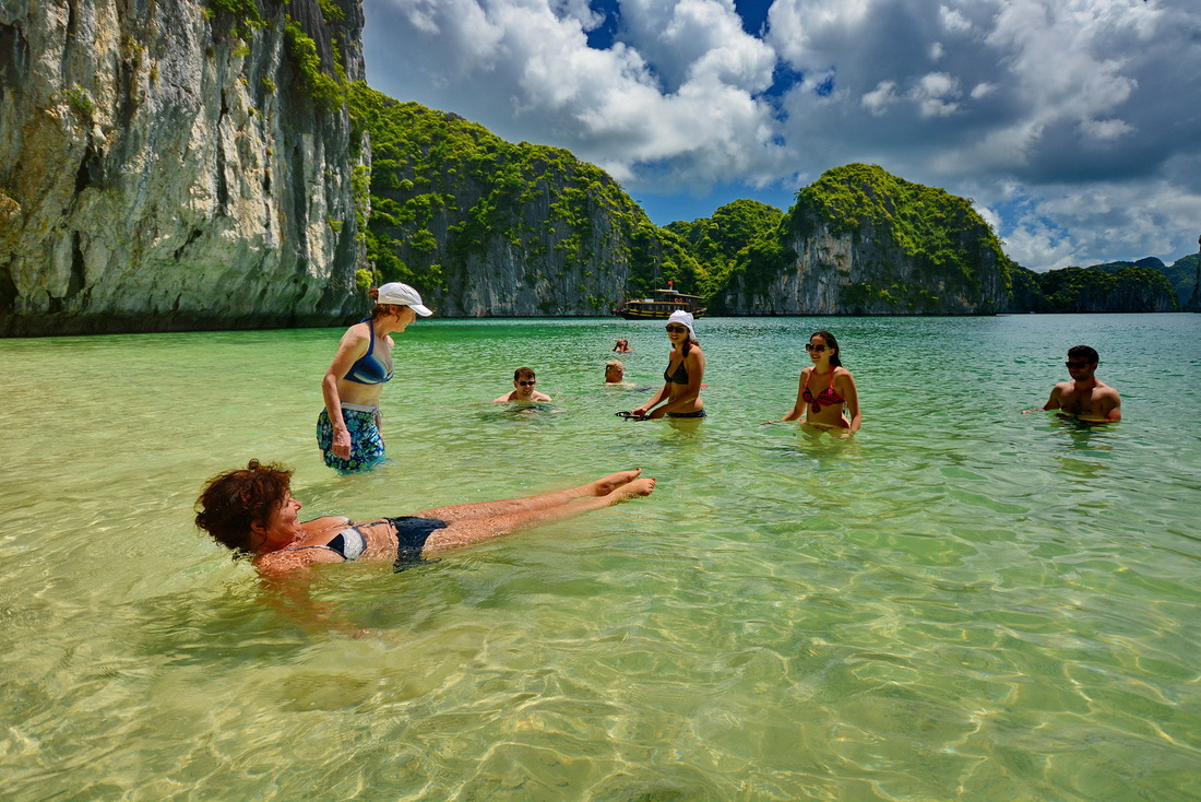 Swimming and sunbathing in Halong