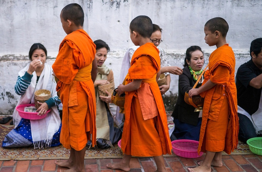Little Monks Collecting Alms At Tak Bat Ceremony