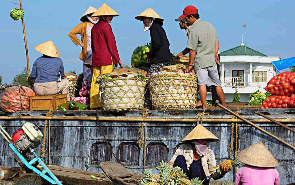 Mingle with locals at the floating markets in Mekong Delta