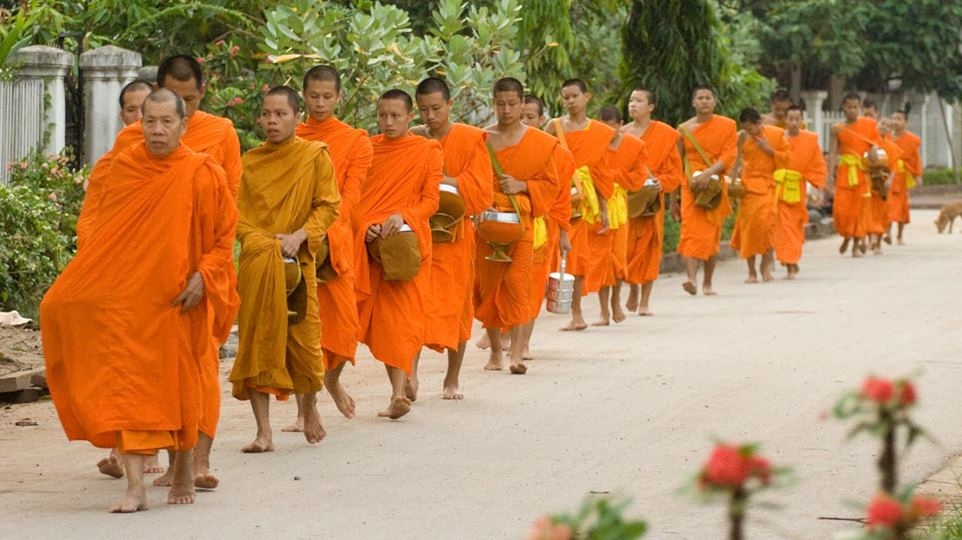 Wakingup early to watch the monks collect alms is amust