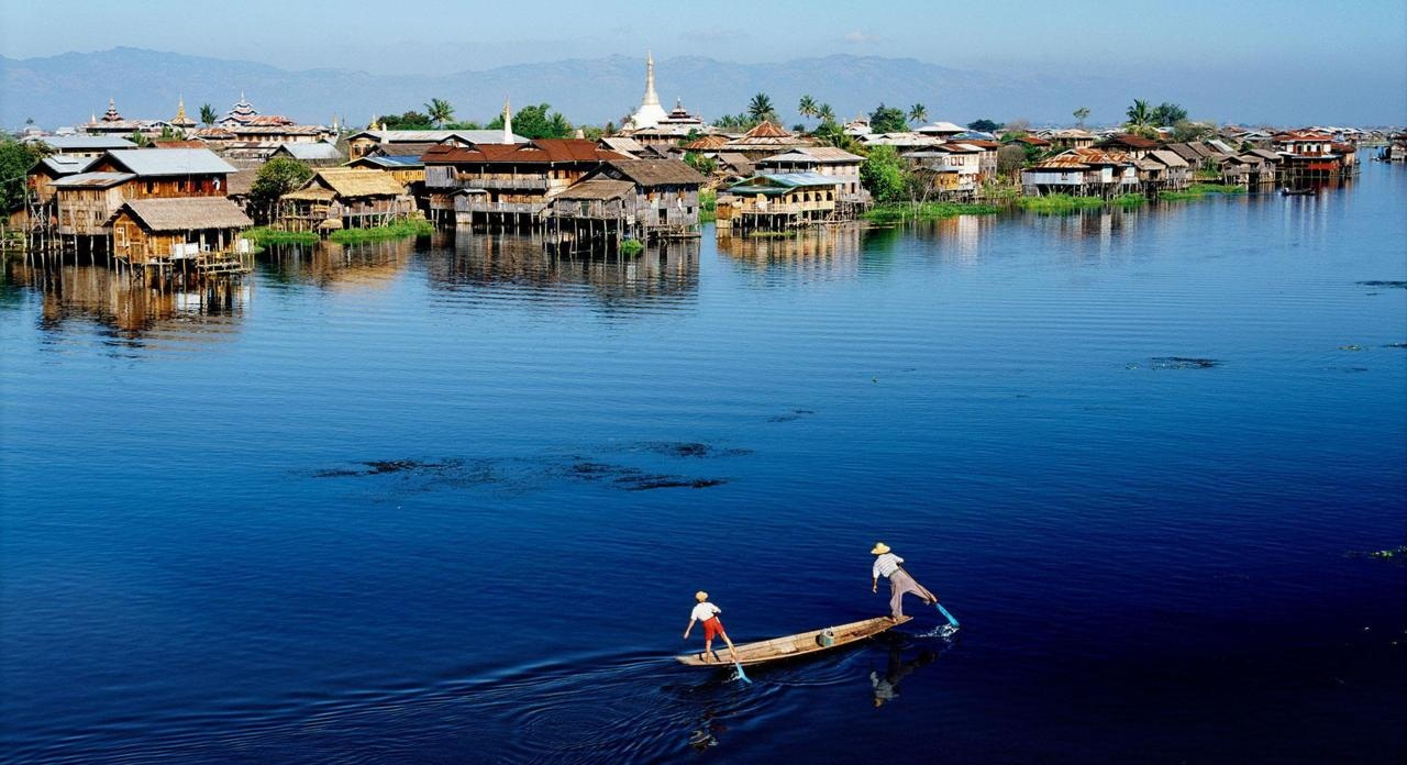 The serenely picturesque Inle Lake, famous for its floating villages, gardens and markets and the unique way of life.