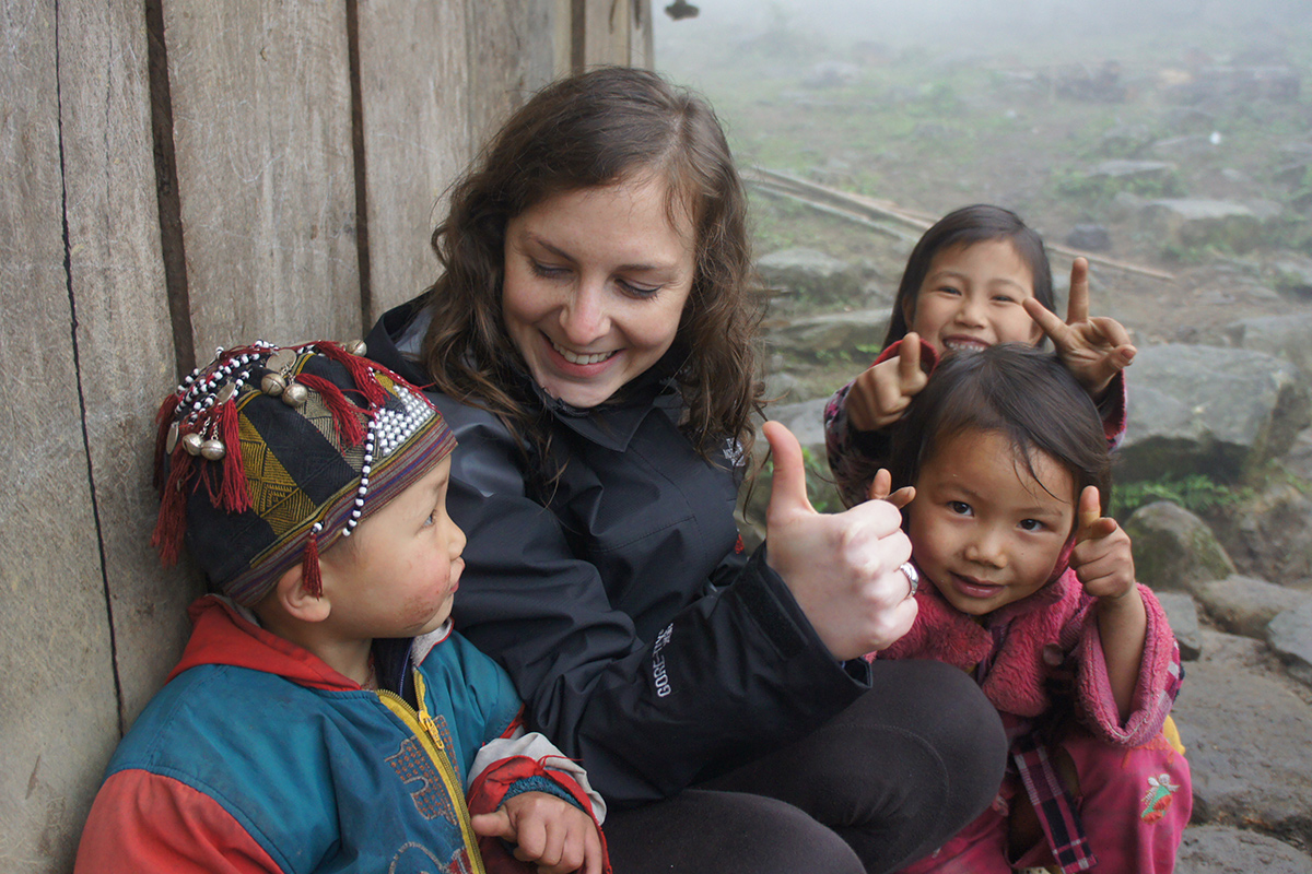 Travelers make friend with lovely kids during a rural homestay experience in Sapa