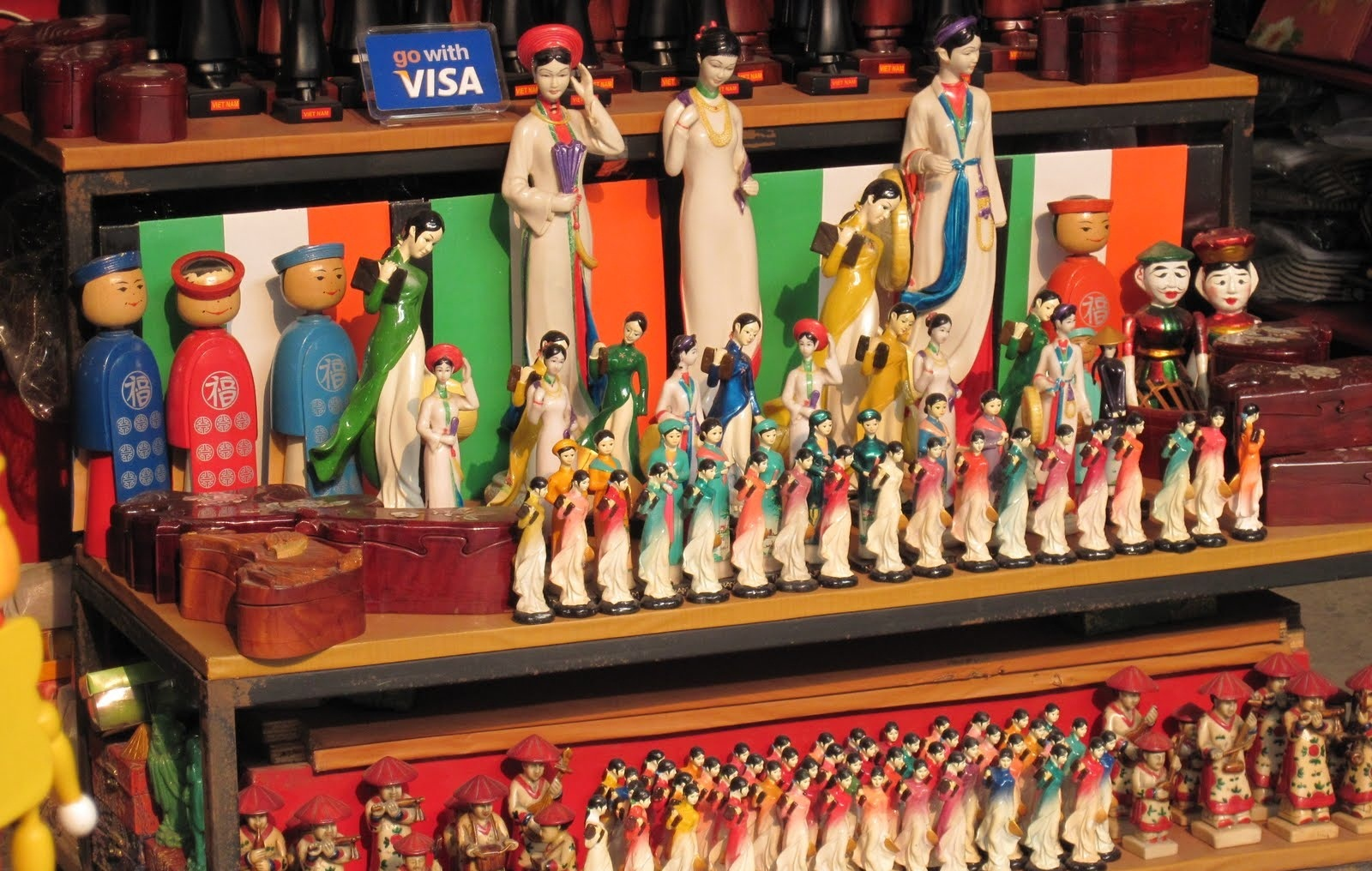 Why not to bring home some of these cute wooden dolls in traditional Vietnamese costumes?
