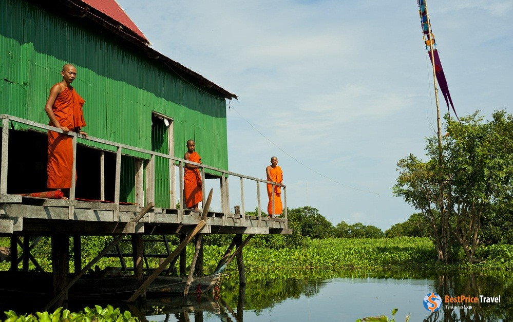 "Cambodian monks in a ""floating village"""