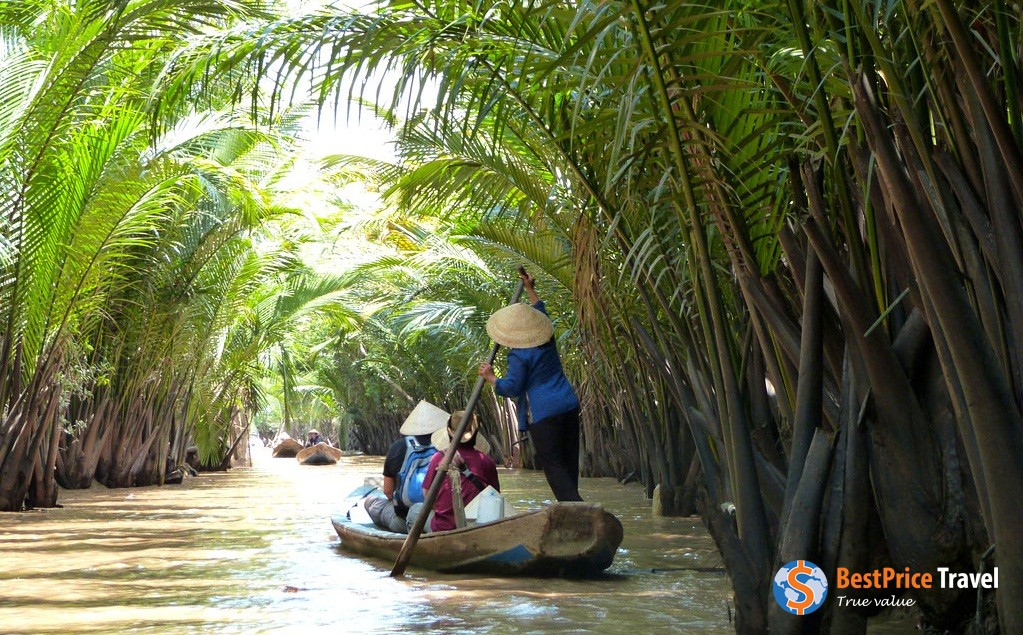Leisurely boat trip along narrow canals in Mekong Delta