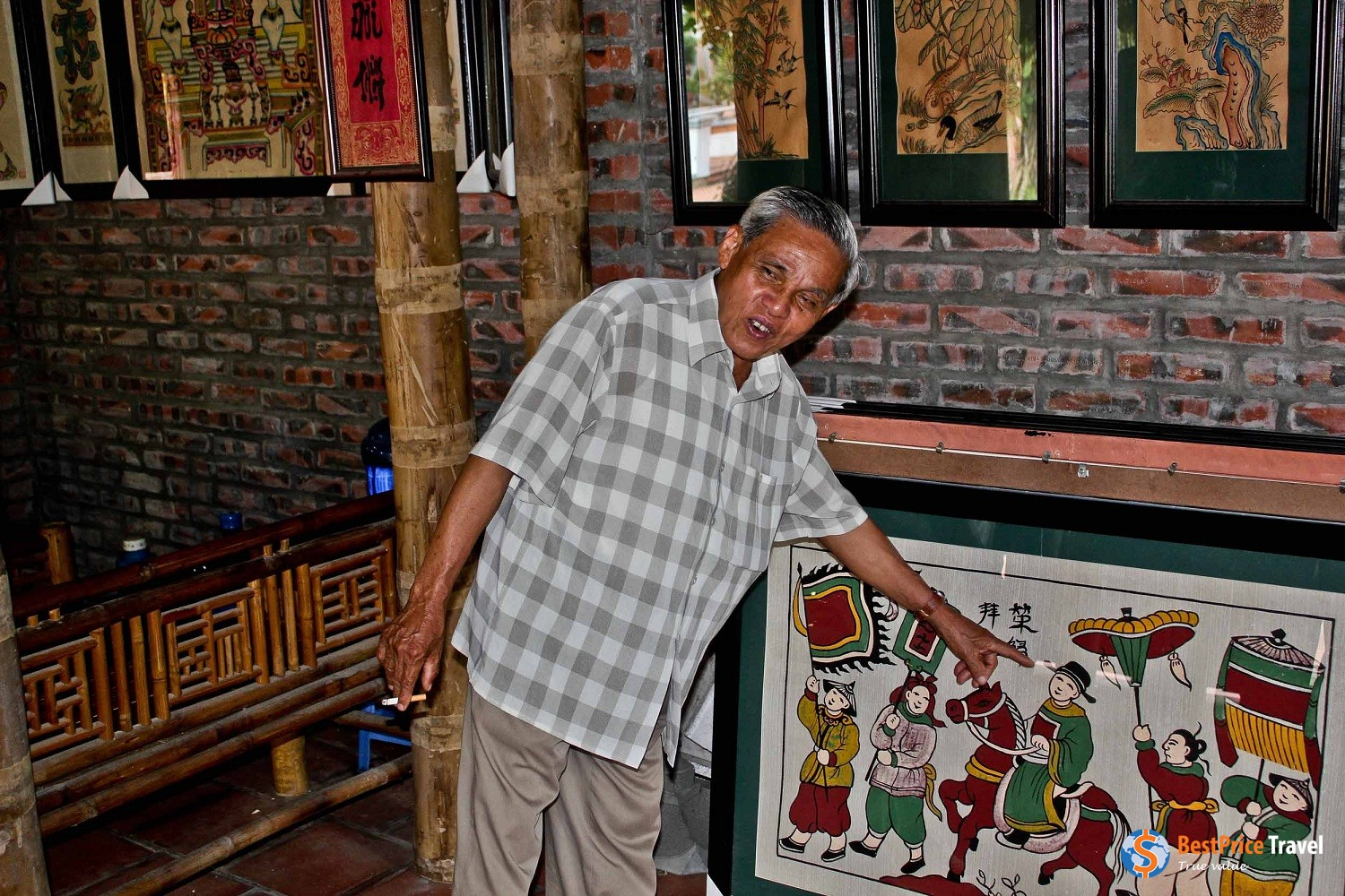Local artisan explaining the concept of the painting.