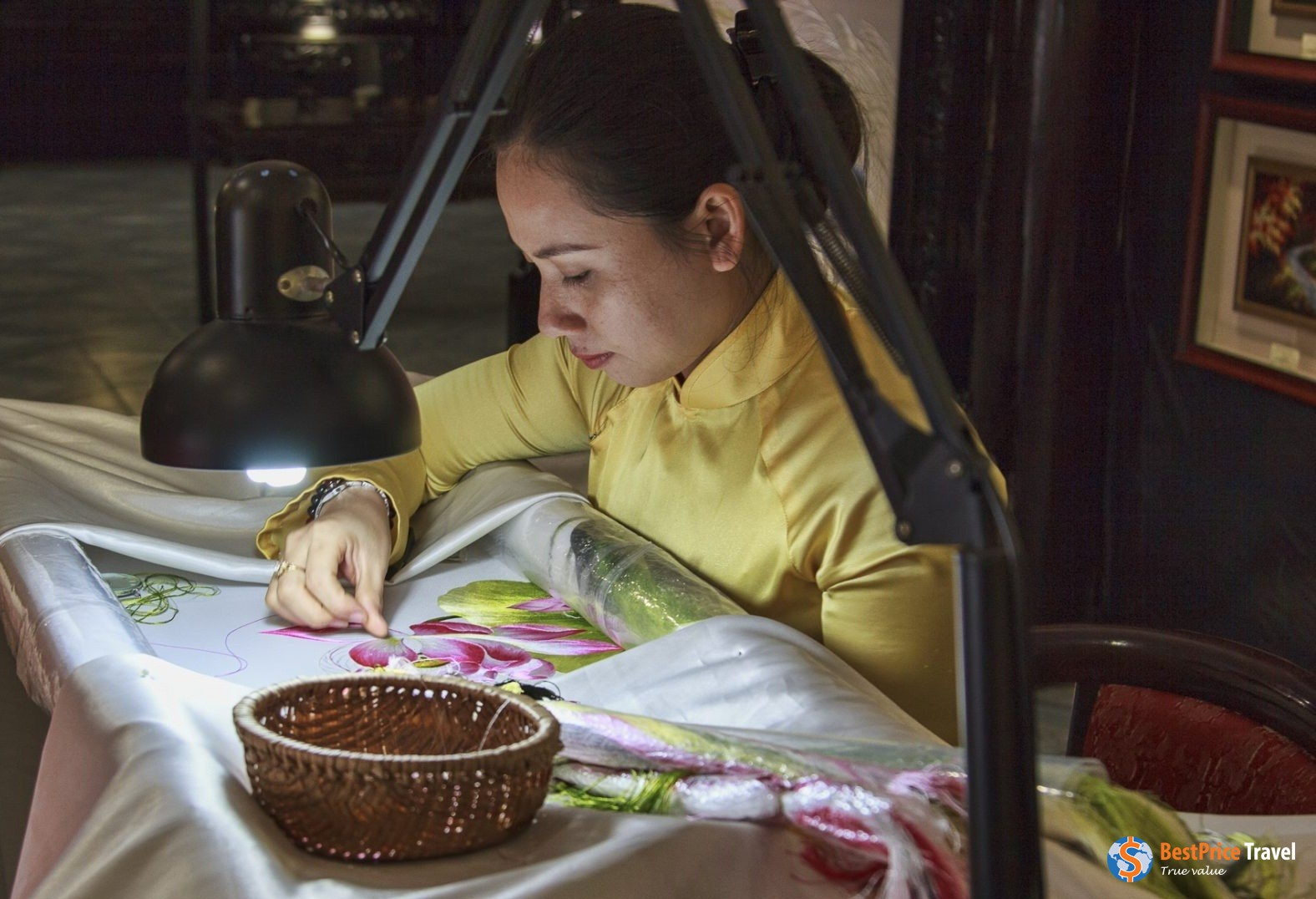 Lady at work in XQ Historical Embroidery Village Nha Trang.