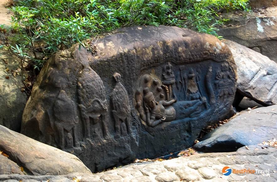 A carving depicts Reclining Vishnu