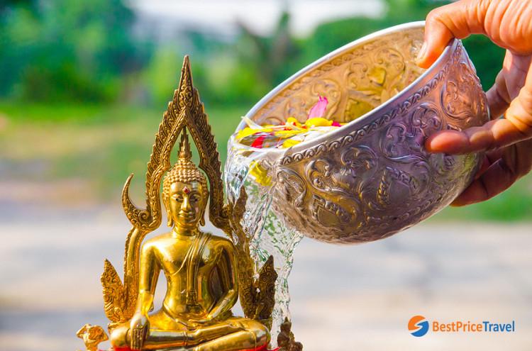 Perfumed water prepared for Buddha statue bathing