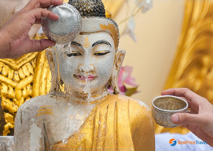 Buddha Statue Bathing in Khmer New Year