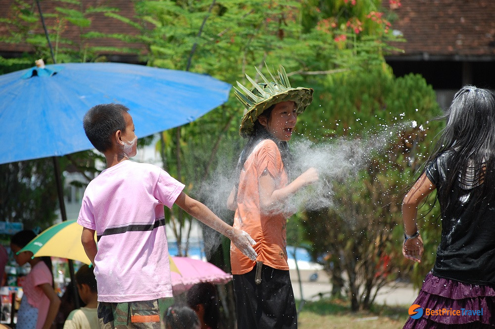 Flour throwing in Laos New Year