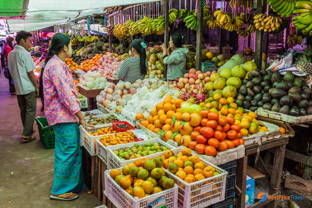 shopping in Inle Lake market for a trip to floating villages here