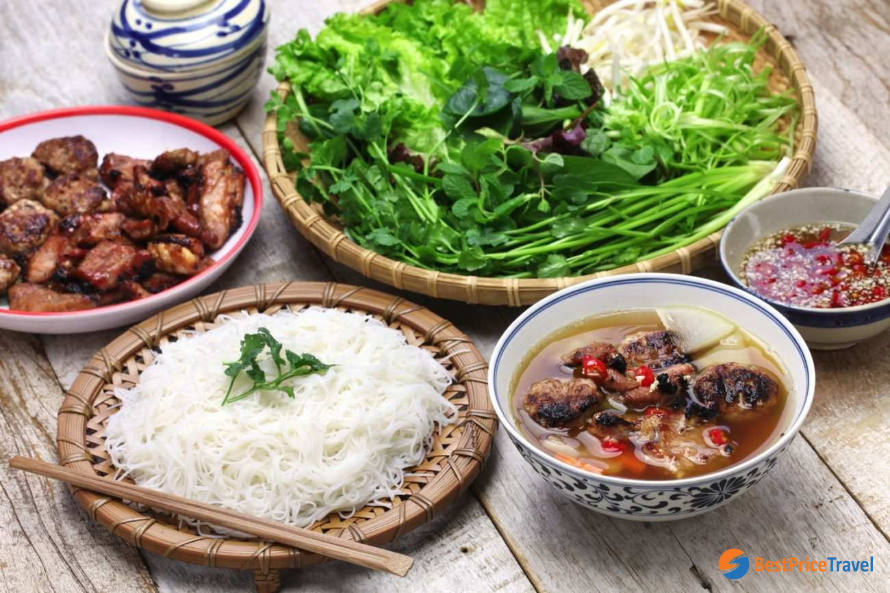 Start your food tour in Hanoi with barbecued pork with rice vermicelli