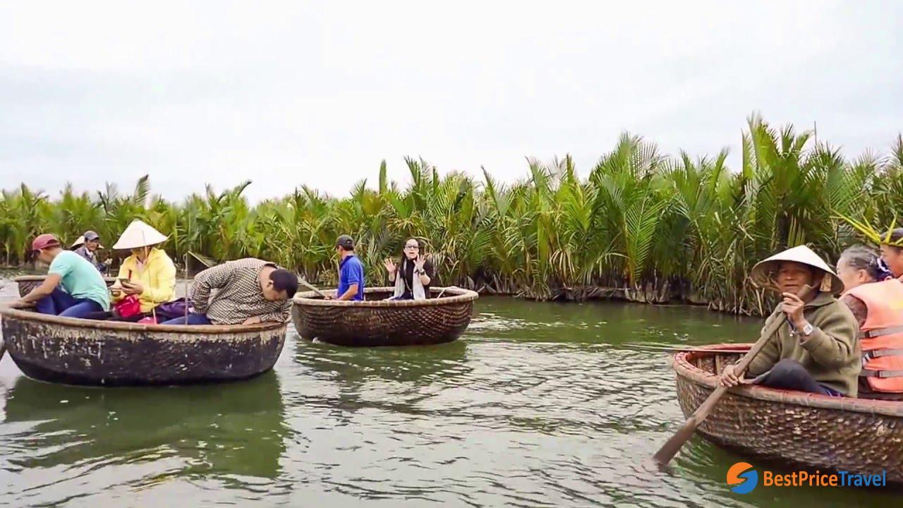 Visiting Mekong delta to row between green trees