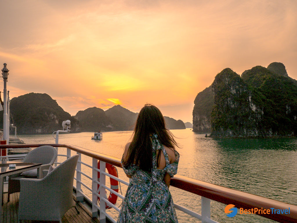 Watching sunset after a full day trip to Halong Bay