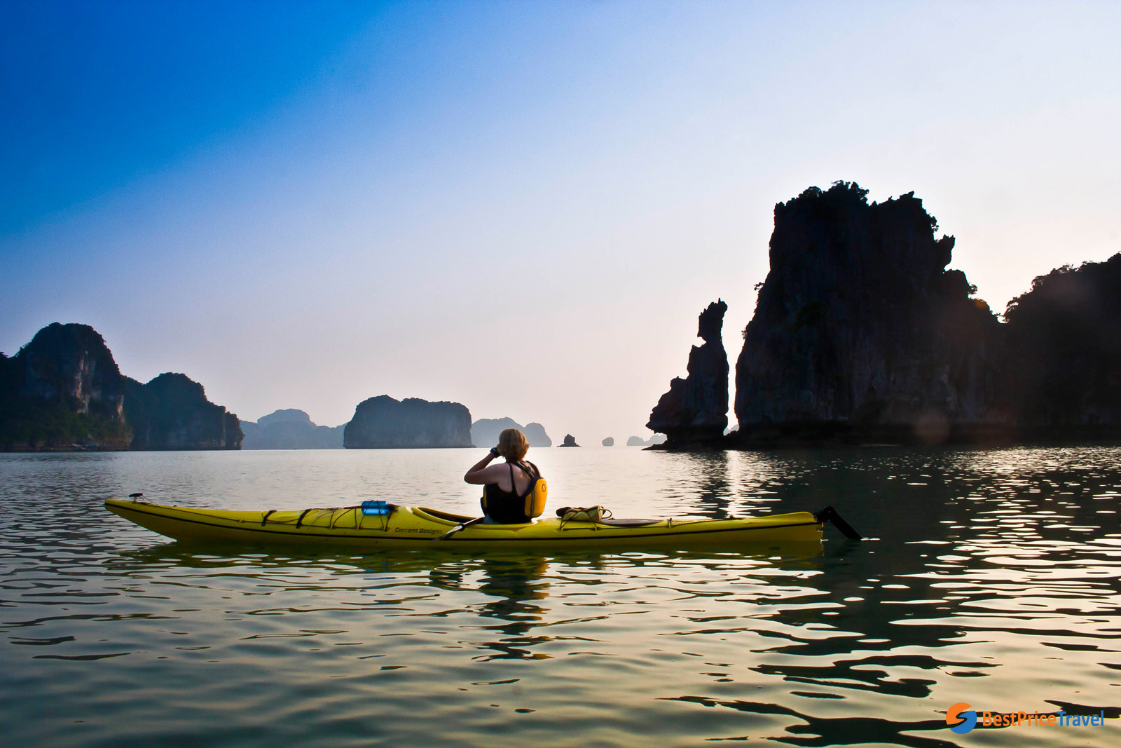 Kayaking is the most exciting activity during Halong Bay full day trip