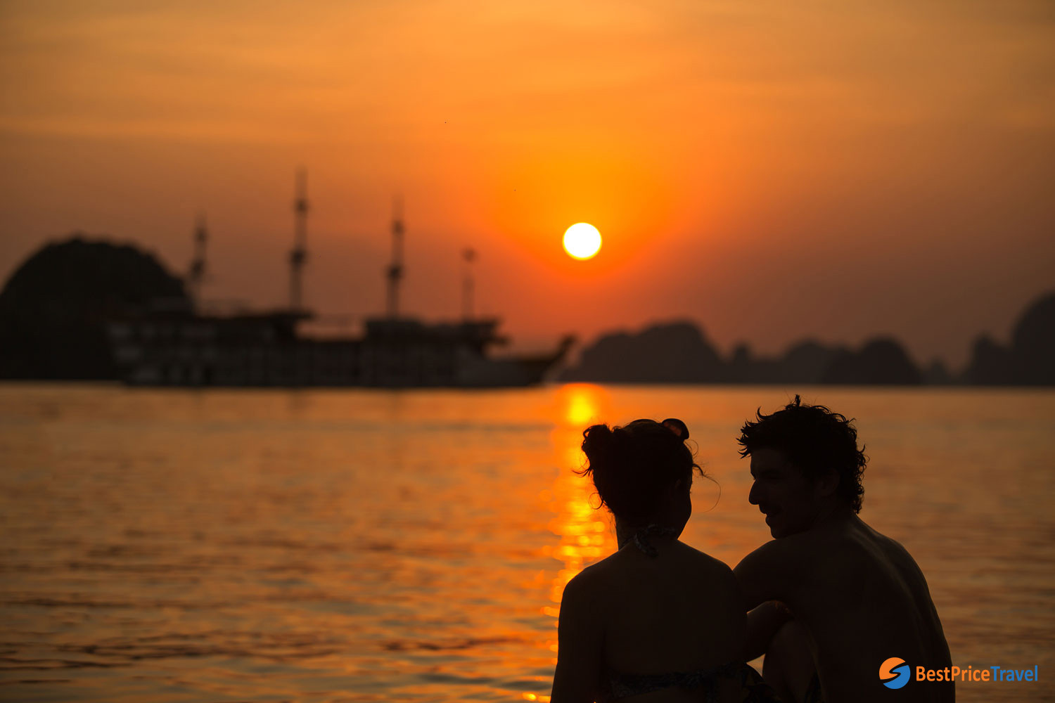 Sunset photo of a couple in Halong Bay