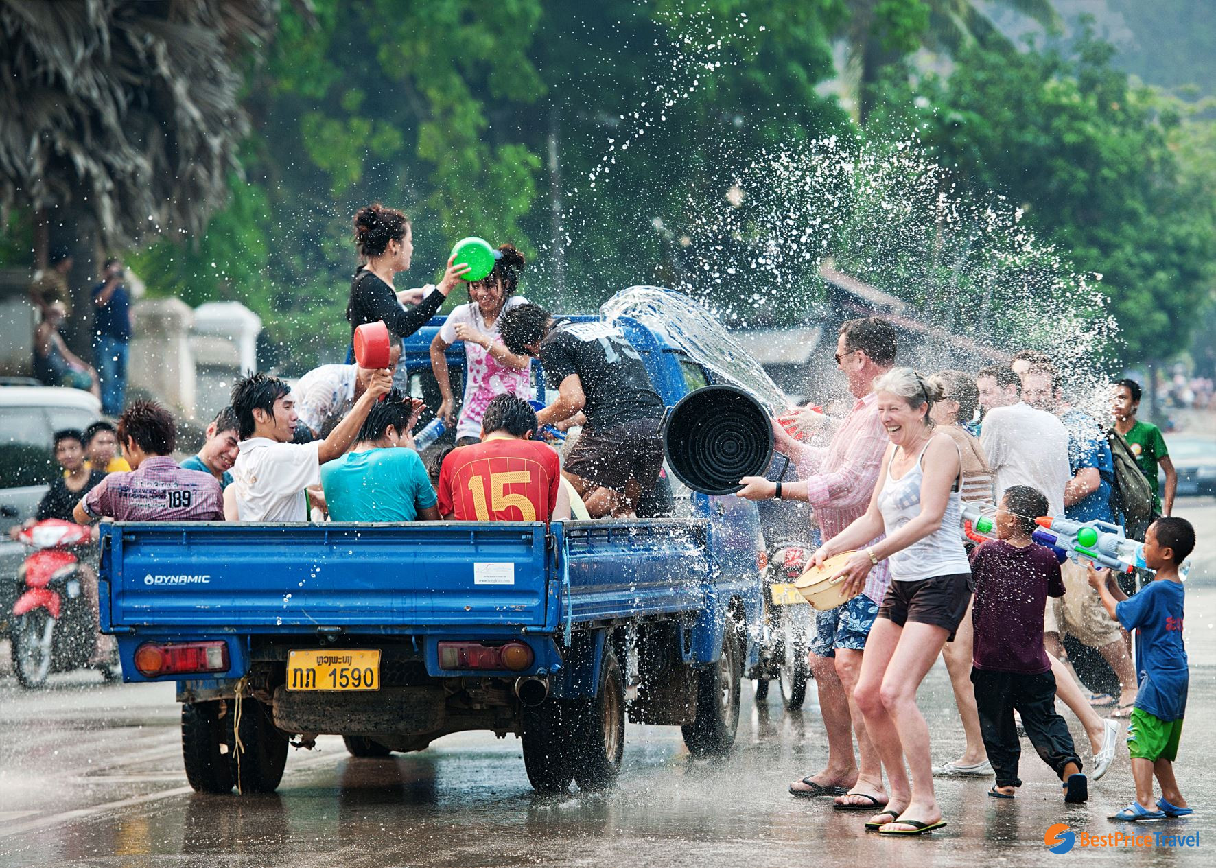 plashing water is considered as a must-do activities giving good luck in Boun Pi Mai