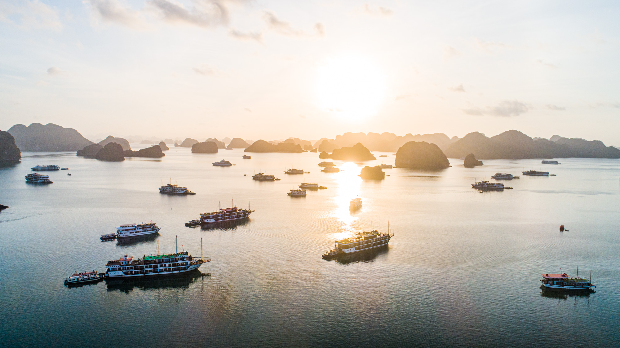 The aquamarine Gulf of Tonkin covers three bays: Halong Bay, Lan Ha Bay and Bai Tu Long Bay.