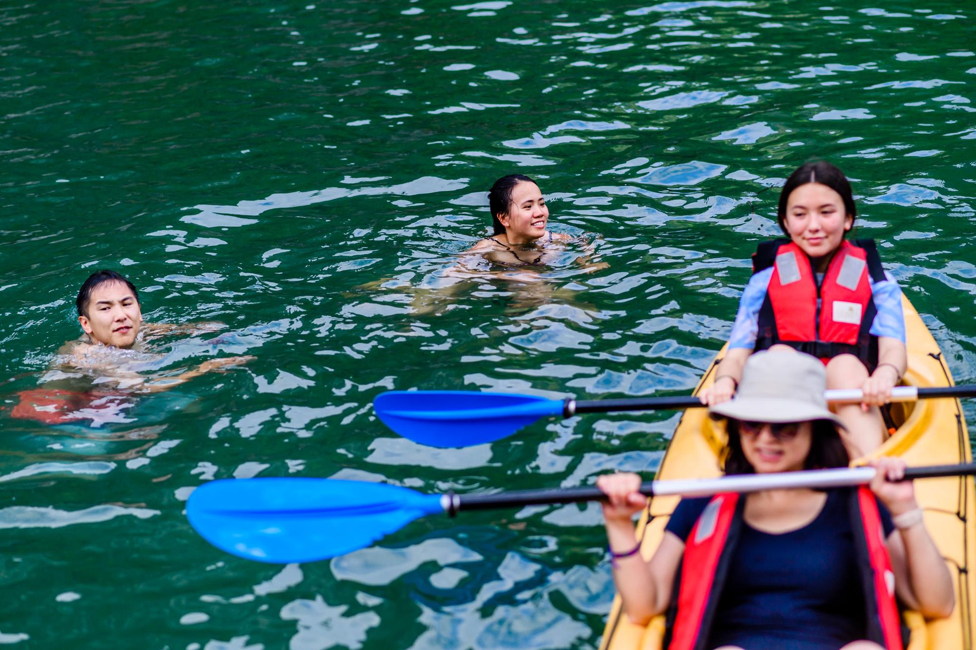 having fun with kayaking in Halong