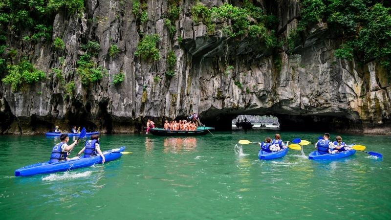 Kayaking in Light and Dark cave Halong Bay