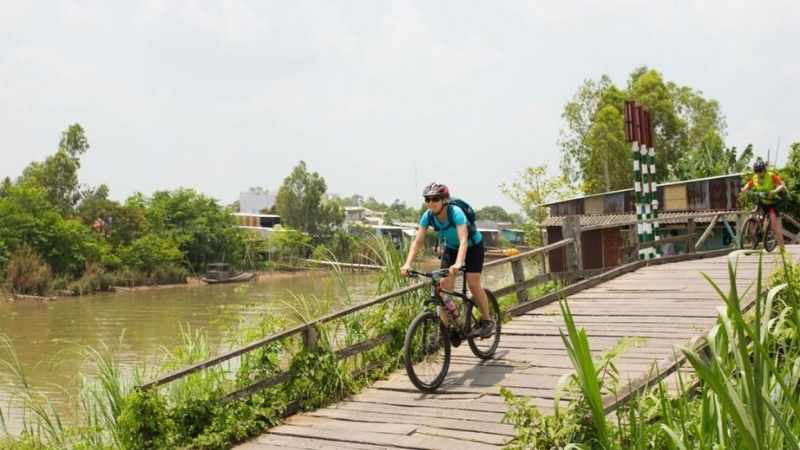 Cycling through local village in Mekong delta
