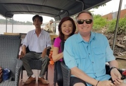 Mr.Charles Dorbandt and his wife in Mekong Delta